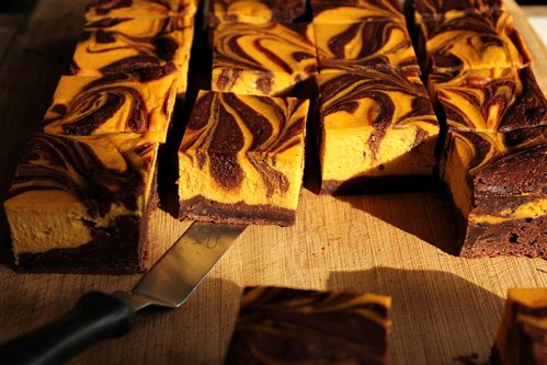 gluten free pumpkin cheesecake brownies on a table