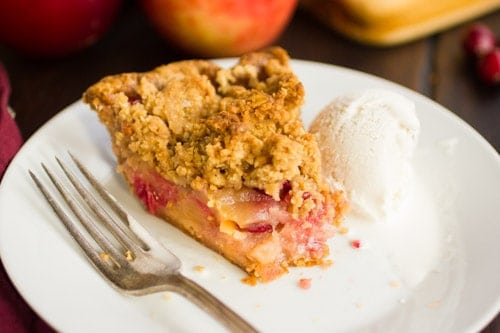 slice of cranberry apple crumble pie