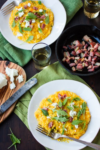 dishes of butternut squash risotto on plates