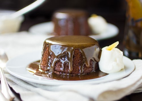 close up of sticky toffee pudding on a plate