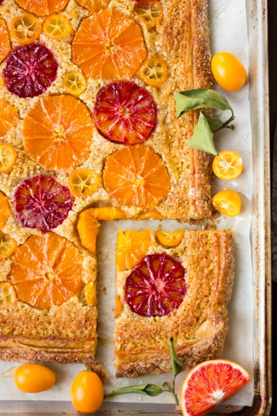 rustic citrus almond tart on a baking tray