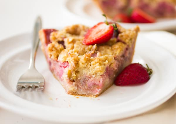 slice of strawberry rhubarb cremefraiche crumble pie