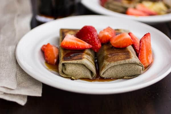 two buckwheat cheese blintzes on a plate