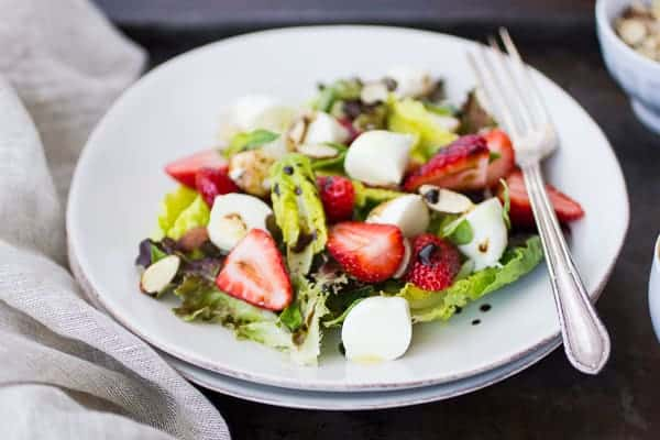 plate full of strawberry caprese salad