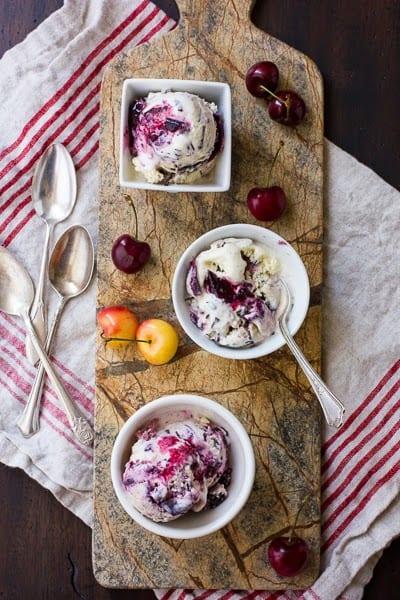 bowls of roasted cherry vanilla ice cream on a board
