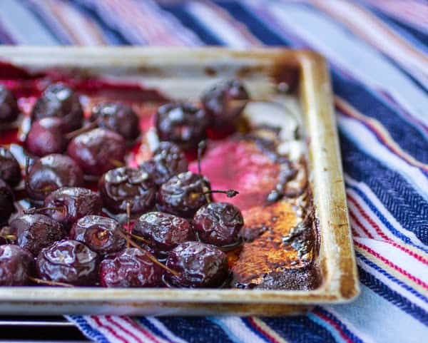 roasted cherries on a tray