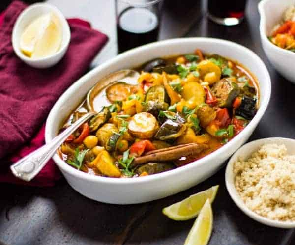 Roasted Eggplant, Chickpea and Summer Vegetable Tagine in pot with rice on side
