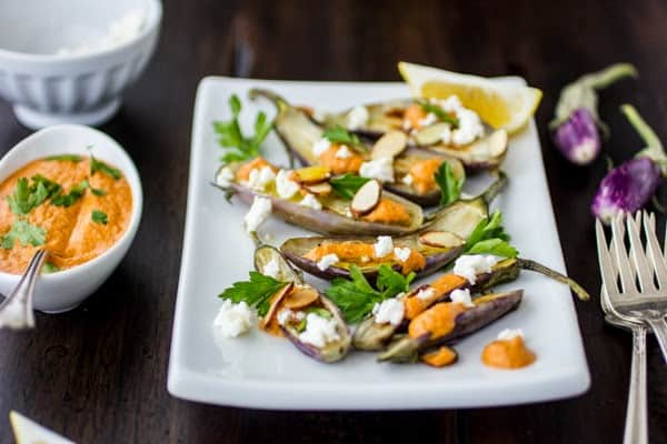 Roasted Tiny Eggplant with Muhammara and Feta on a plate