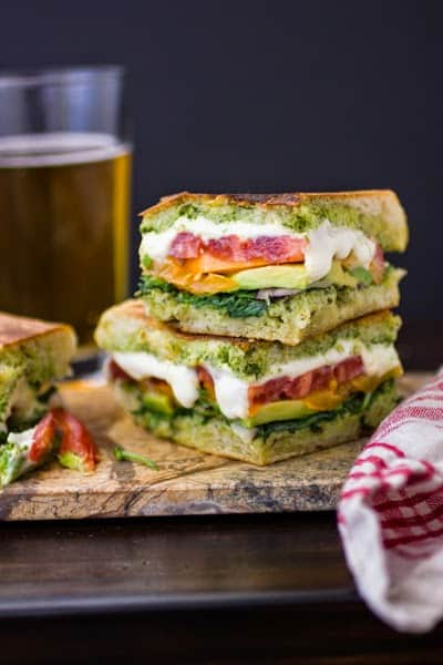 stack of toasted sandwiches with Tomatoes, Mozzarella, and Arugula