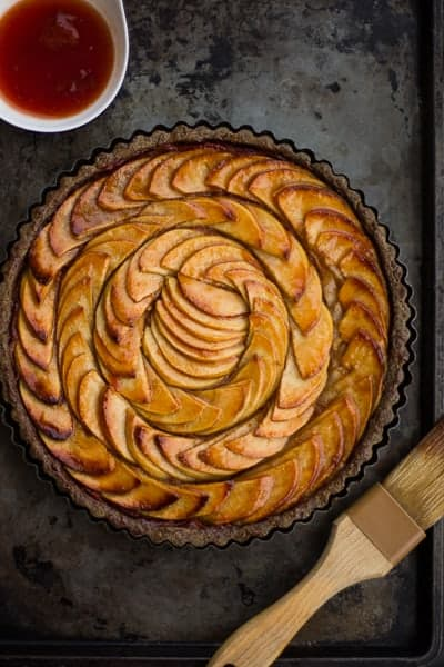 Apple Quince Tart with Gluten-Free Buckwheat Crust on a tray