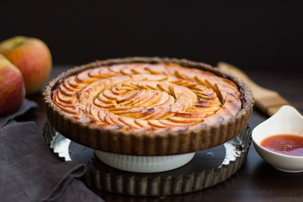 Apple Quince Tart with Gluten-Free Buckwheat Crust on a stand