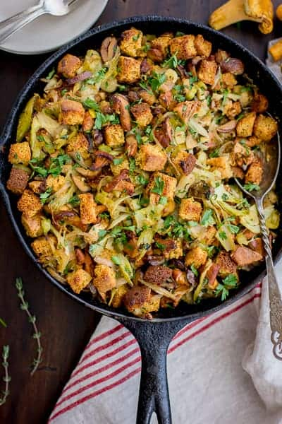 Gluten-Free Cornbread Stuffing with Chestnuts, Leeks, and Chanterelles in a skillet