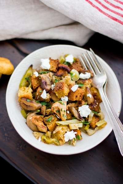 Gluten-Free Cornbread Stuffing with Chestnuts, Leeks, and Chanterelles in a bowl