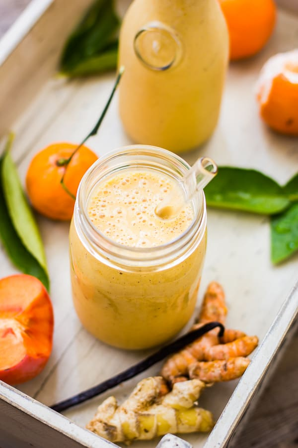 Persimmon and Tangerine Smoothie with Vanilla, Ginger and Turmeric in a glass