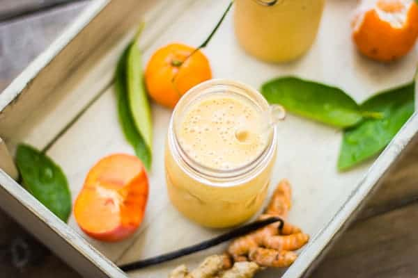 overhead shot of Persimmon and Tangerine Smoothie with Vanilla, Ginger and Turmeric