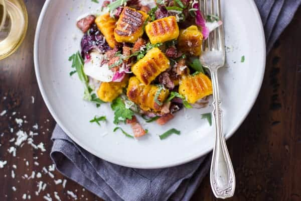 plate of delicious Gluten-Free Pumpkin Ricotta Gnocchi with Pancetta and Seared Radicchi