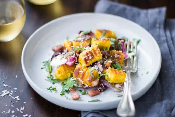 plate of Gluten-Free Pumpkin Ricotta Gnocchi with Pancetta and Seared Radicchio