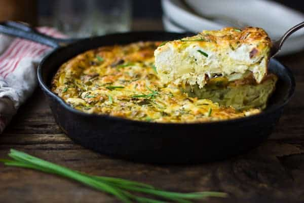 slice of Potato and Green Garlic Crustless Quiche with Goat Cheese, Gruyère, and Chives {Gluten-Free}