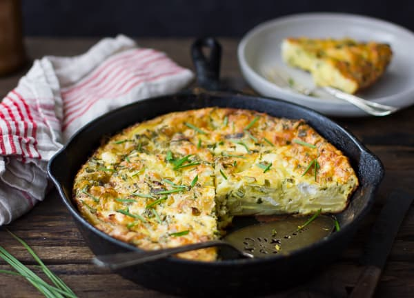 Potato and Green Garlic Crustless Quiche with Goat Cheese, Gruyère, and Chives {Gluten-Free} in a pan