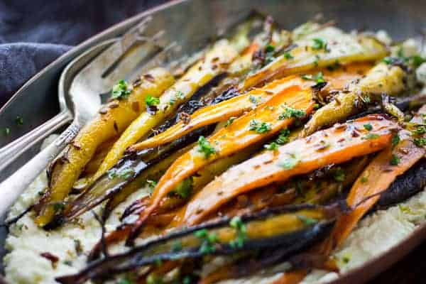 close up of Cumin and Honey Roasted Carrots, Ricotta, and Gremolata
