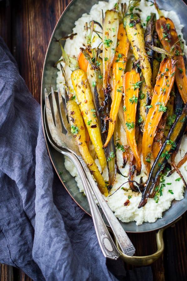 Cumin and Honey Roasted Carrots, Ricotta, and Gremolata on a dish