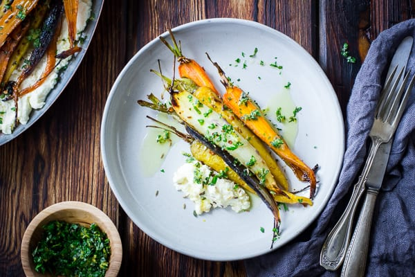 Cumin and Honey Roasted Carrots, Ricotta, and Gremolata on a plate
