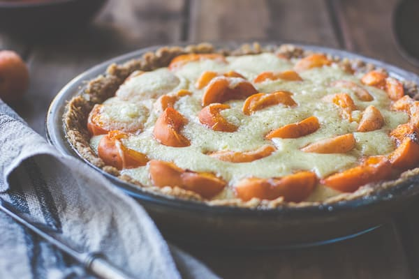 side shot of  Apricot Custard Pie with Cardamom Crumble Crust {Gluten-Free}