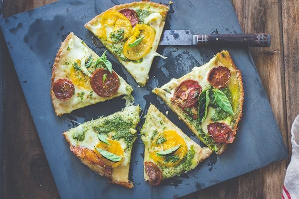 Tomato + Pesto Socca Pizza {Gluten-Free} on a board