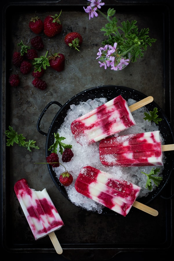 overhead shot of Tayberry, Rose Geranium + Buttermilk Popsicles