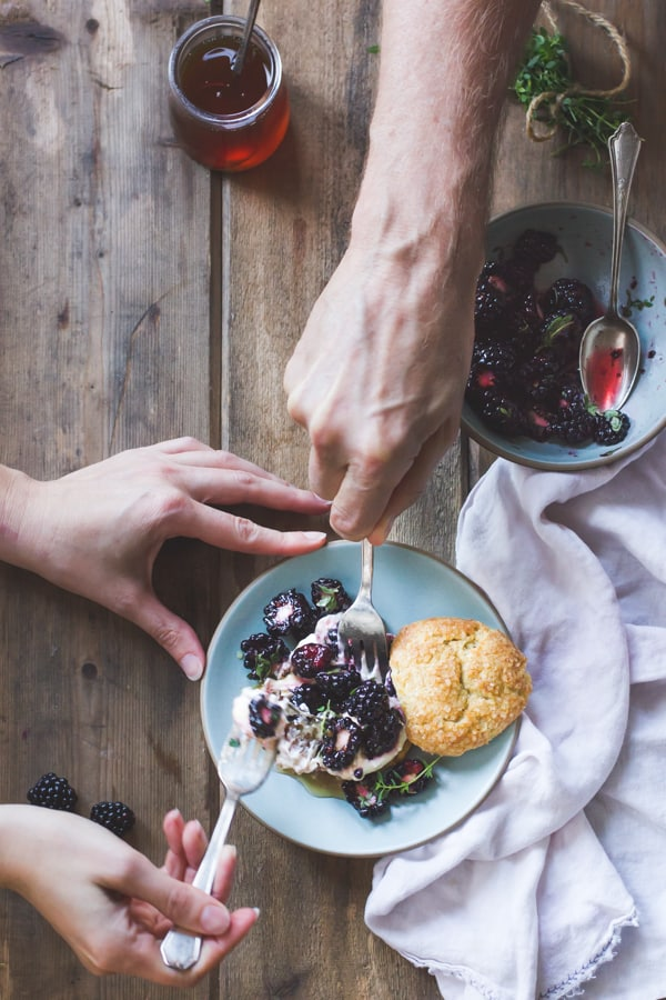hands with forks cutting into Ricotta Blackberry Shortcakes with Honey and Thyme {Gluten-Free}