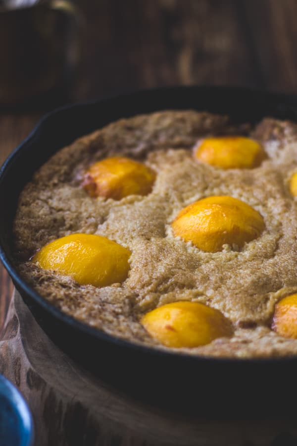 close up of Southern-Style Peach Cobbler with Maple Sugar, Bourbon + Brown Butter {Gluten-Free}