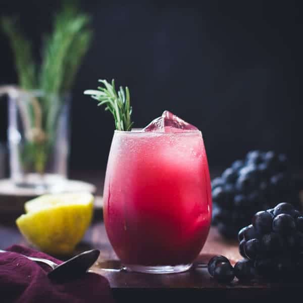 Zinfandel Grape, Rosemary + Gin Crush in a glass