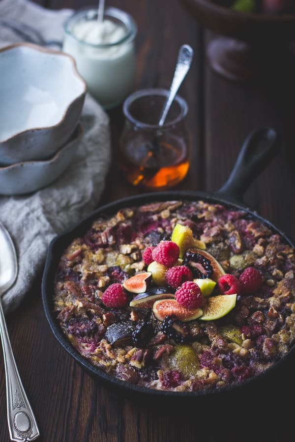 delicious Baked Rolled Barley with Figs, Berries, and Cardamom in a skillet