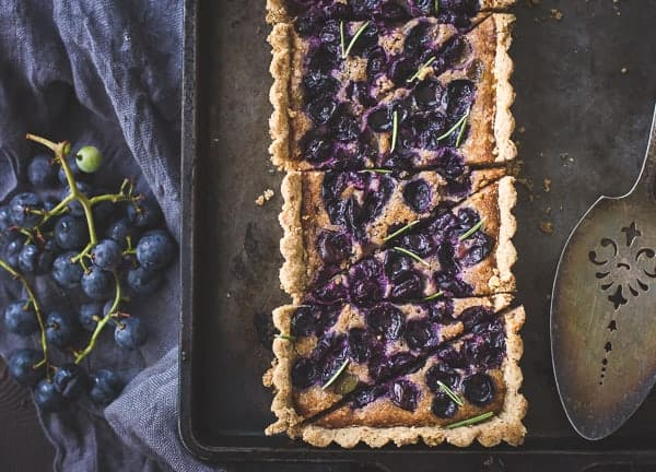 delicious Concord Grape + Walnut Frangipane Tart with a Gluten-Free Rosemary Crust