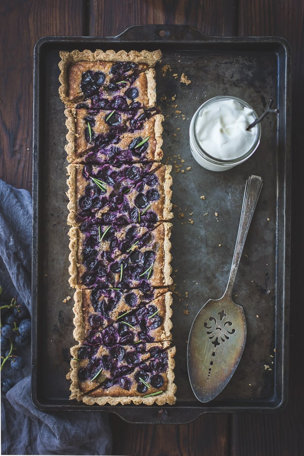 tray of Concord Grape + Walnut Frangipane Tart with a Gluten-Free Rosemary Crust