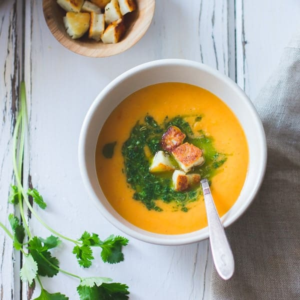 delicious Roasted Yellow Tomato Soup with Green Harissa + Halloumi Croutons