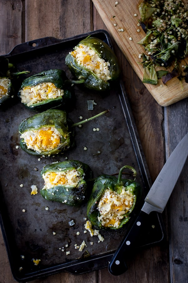 Roasted Poblano Chiles Stuffed with Cheesy Butternut Squash Quinoa + Pepita Crema on baking tray