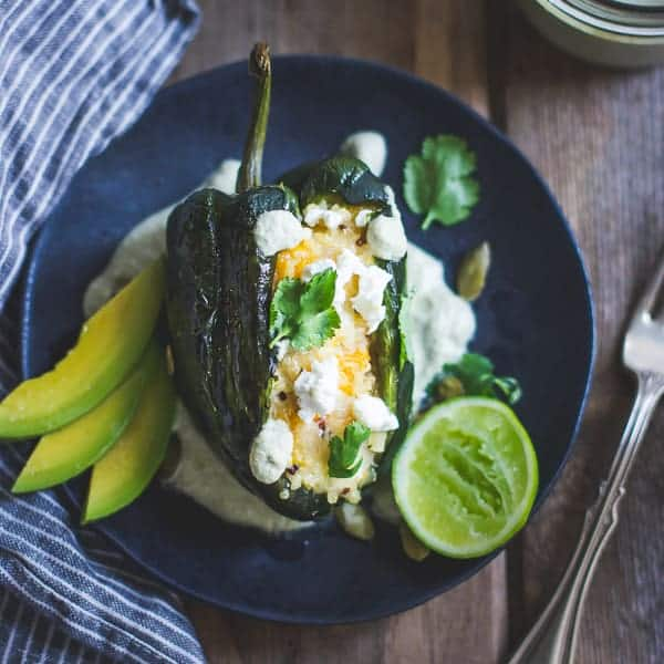 delicious Roasted Poblano Chiles Stuffed with Cheesy Butternut Squash Quinoa + Pepita Crema