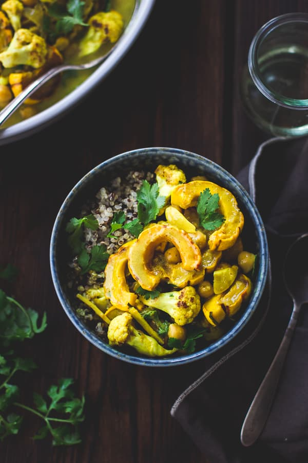 Roasted Delicata Squash, Cauliflower + Chickpea Curry in a bowl
