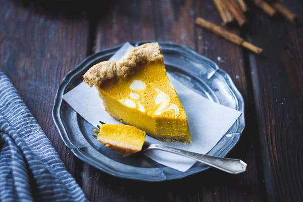big slice of Kabocha Pumpkin Buttermilk Pie with a Crème Fraîche Swirl {Gluten-Free