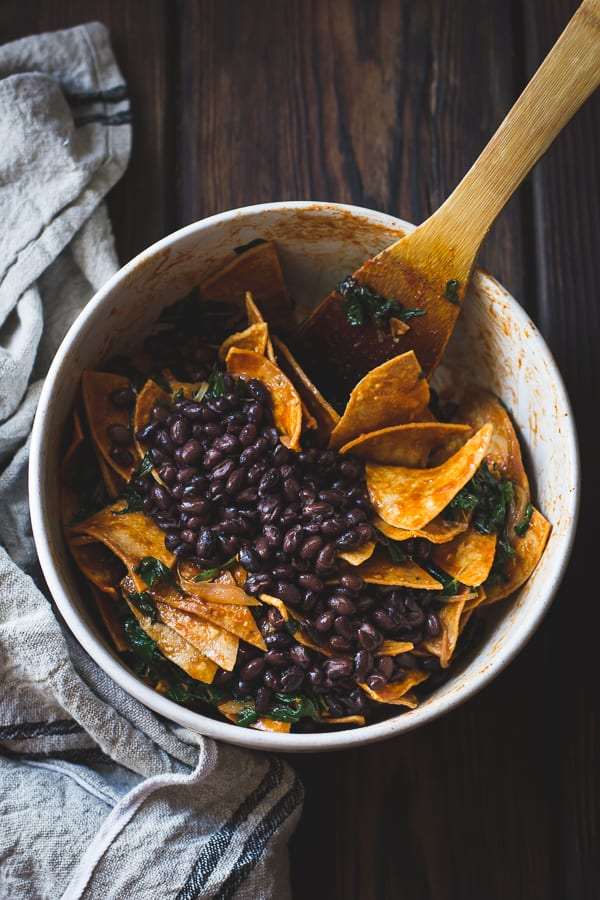 Baked Chilaquiles with Black Beans and Kale mixed in bowl