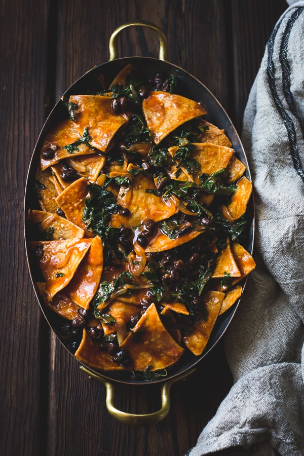 Baked Chilaquiles with Black Beans and Kale in big pan