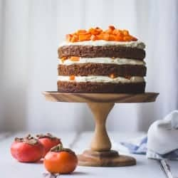 Two-Persimmon Layer Cake with Vanilla Bourbon Cream Cheese Frosting on stand