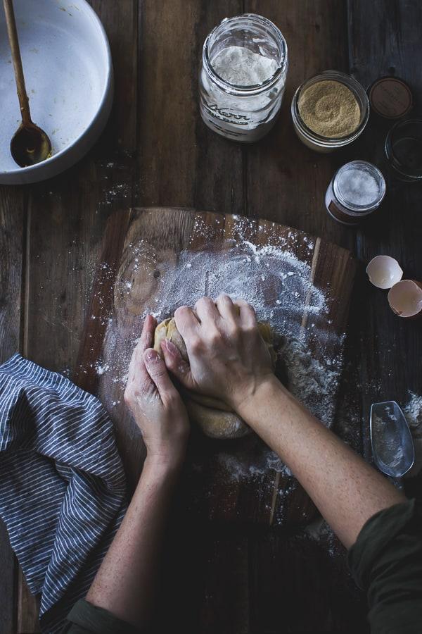 hands pressing dough