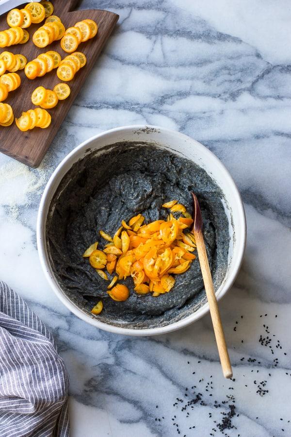 tea cake mix and kumquat slices in bowl