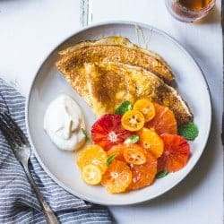 Gluten Free Crepes With Ricotta, Citrus, and Honey on plate