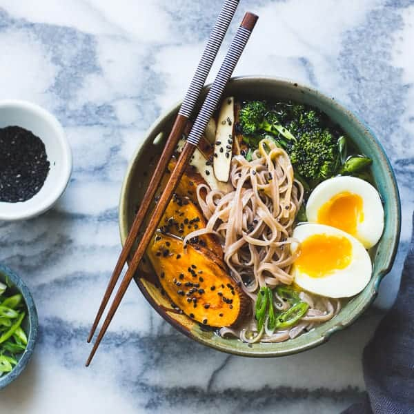 a bowl of delicious Vegetarian Miso Ramen with Rice Noodles, Roasted Sweet Potatoes + Sesame Broccolini