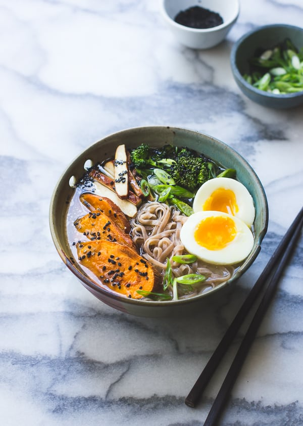 Vegetarian Miso Ramen with Rice Noodles, Roasted Sweet Potatoes + Sesame Broccolini in bowl on table