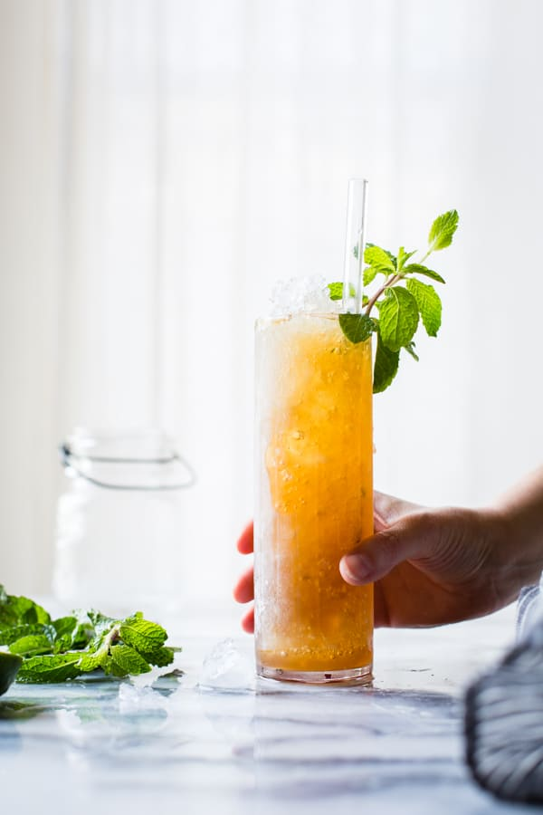 hand holding Muscovado Mint Julep