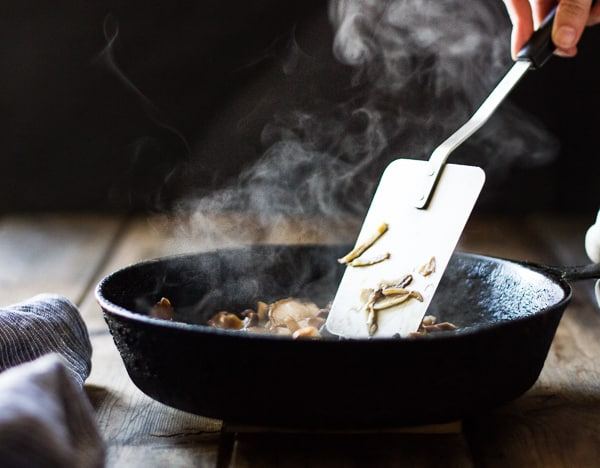 mushrooms stirred in pan